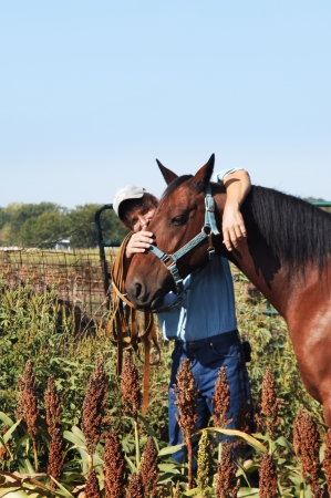 Horse and owner enjoy a moment of friendship while standing in a field of milo in central Kansas.