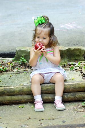 Apple a day for baby, makes this little girl happy photo