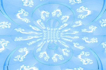Elegant background of soft blue.  White scrollwork and fancy swirls decorate large blue circles mirrored in double image. Stock Photo - 15109812
