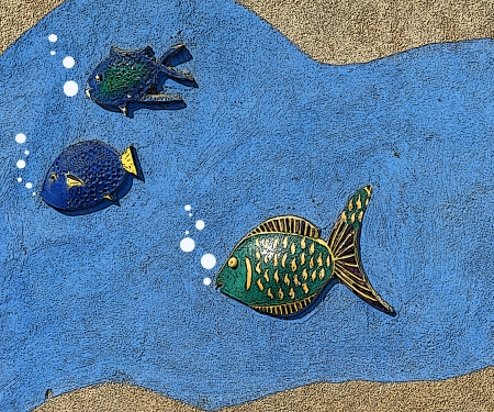 Colorful graphic illustration of marine life swimming in blue water rimmed by sand   Three fish have bubbles escaping from their mouths
