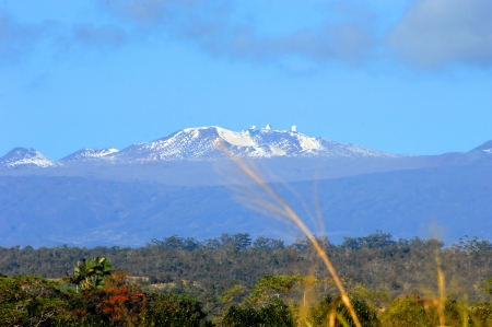 labratory: Low elevation view of the observatory at the top of Mauna Kea   Big Island is tropical but also has the snow capped peak of Mauna Kea