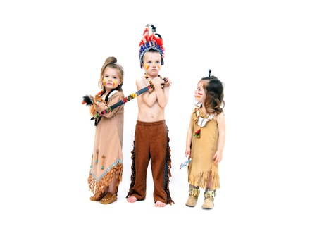 Adorable kids dressup for Halloween in indian costumes.  They are ready for war with their weapons and fierce expressions. photo