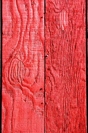Red, painted boards fill background   Boards are rough in texture and shows wood grain  Banco de Imagens