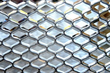 Background image is composed of leaded glass with each piece faceted