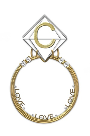 karat: The letter C, in the alphabet set Diamond Ring, is gold and sits on a faceted diamond set in a 14 karat gold ring. Stock Photo