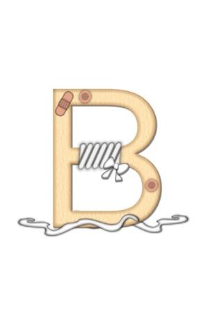 doctoring: Alfabeto lettera B, nel Boo Boo set, � tan per rappresentare il colore della pelle. Ogni lettera � fasciata e ha applicato cerotti. Strisce di Guaze e forbici anche decorare lettere.