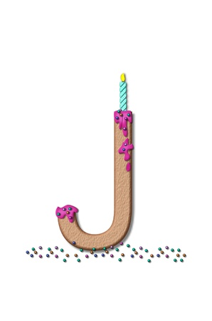 frosting: The letter J, from the alphabet set Happy Birthday, is tan with cake-like textured fill.  Letter is iced with pink frosting and sprinkled with tiny candies.  Candle sets in frosting on top of letter. Stock Photo