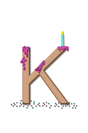 The letter K, from the alphabet set Happy Birthday, is tan with cake-like textured fill.  Letter is iced with pink frosting and sprinkled with tiny candies.  Candle sets in frosting on top of letter. photo
