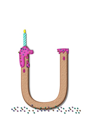 fill fill in: The letter U, from the alphabet set Happy Birthday, is tan with cake-like textured fill.  Letter is iced with pink frosting and sprinkled with tiny candies.  Candle sets in frosting on top of letter. Stock Photo