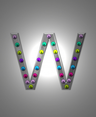 aluminum: The letter W, in the alphabet set Metal Marquee, is grey metal illuminated by multi-colored light bulbs.  Background is grey with glowing white light. Stock Photo