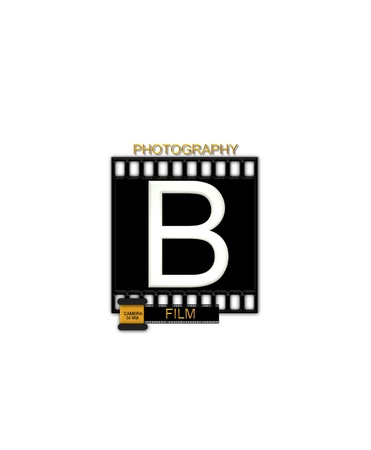 typographiy: The letter B, in the alphabet set Camera Film is white and is sitting on a black strip of film.  A small film canister sits at base of letter.