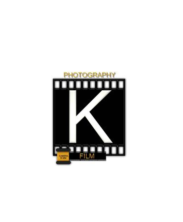 typographiy: The letter K, in the alphabet set Camera Film is white and is sitting on a black strip of film.  A small film canister sits at base of letter. Stock Photo