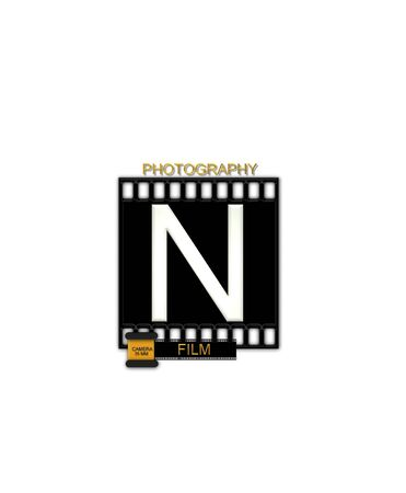 typographiy: The letter N, in the alphabet set Camera Film is white and is sitting on a black strip of film.  A small film canister sits at base of letter.