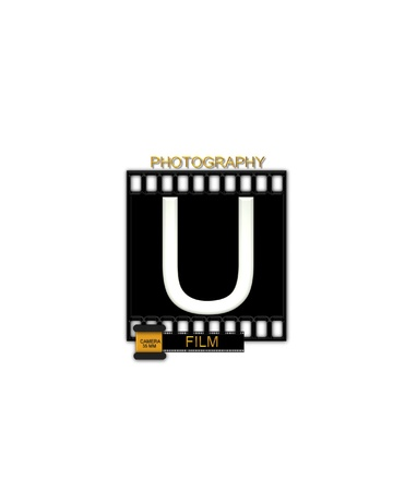 typographiy: The letter U, in the alphabet set Camera Film is white and is sitting on a black strip of film.  A small film canister sits at base of letter.