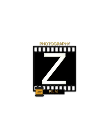 typographiy: The letter Z, in the alphabet set Camera Film is white and is sitting on a black strip of film.  A small film canister sits at base of letter.