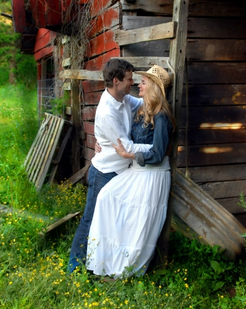 Rustic, weathered barn serves as backdrop for romantic couple photo