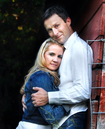Young couple lean close, trusting in the strength of their marriage photo