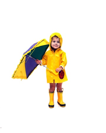 Adorable little girl stands holding an open umbrella photo