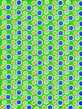 Soft focused polka dots are outlined in white.  Blue, Orange and green cirles fill foreground and background. photo