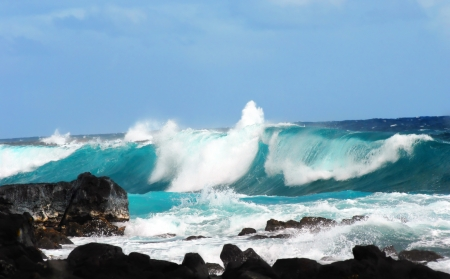 Large wave curls and spills over itself as it crashes against the rocks in Mackenzie State Park on the Big Island of Hawaii   Windy conditions causes ocean to produce large waves and spray