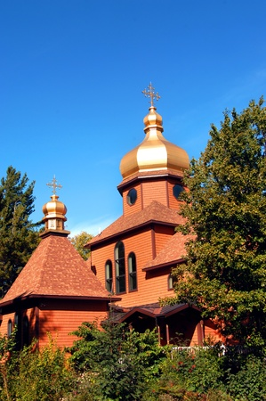 secluded: Cupola and cross of the Society of St. John, top simple monastery in Upper Penninsula, Michigan.  Building is along the order of the Russian Orthodox Architecture.