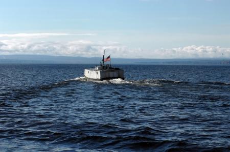 """encrespado: Construido como un tanque, y localmente conocido como el """"submarino Terminar"""", el buque robusto navega por las agitadas aguas del lago Superior."""
