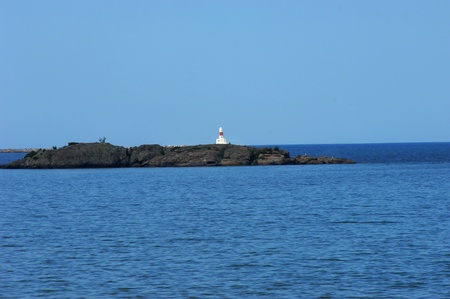 marquette: Marquette Bays blue waters frame the Presque Isle Lighthouse and breakwater. Stock Photo