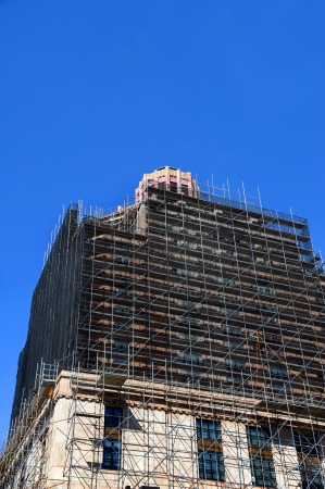 Extensive restoration progresses on the art-deco style architecture of the Asheville City Hall in North Carolina.  Scaffolding engulfs much of the buildings exterior.