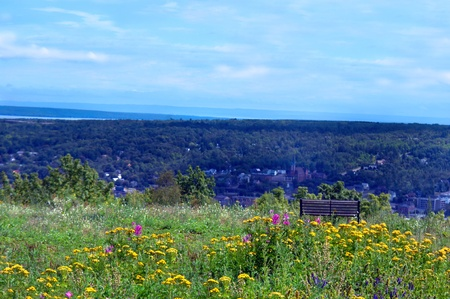 upper peninsula: Park bench sits on top of Quincy Hill overlooking the town of Houghton, Michigan.  Sweeping vista includes Lake Superior.