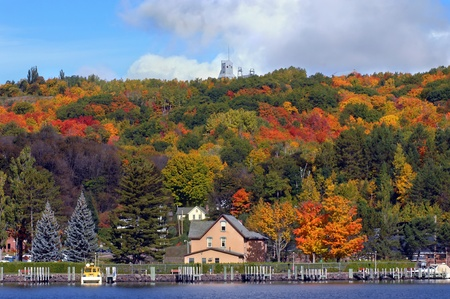 upper peninsula: Scenic view includes Hancock, Michigan and piers with Quincy Copper Mine on hilltop.  Fall foliage colors scene. Stock Photo