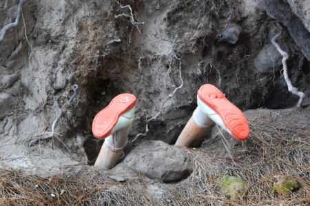 dirty feet: Mannequin is buried head first on the Big Island of Hawaii   You could say  buried alive  or  upside down  or  bottoms up