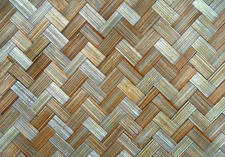 antiqued: Zig zag pattern is composed of interlocking pieces of rattan woven into a matt background