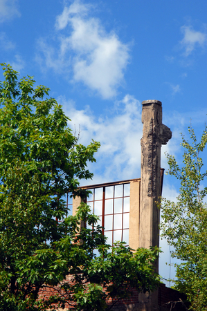 flotation: The Quincy Mill flotation building stands in ruins and overgrown with weeds and bushes   This building is a remnant of the copper mining industry in the Upper Peninsula
