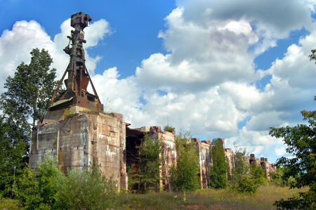 upper peninsula: Remains of Ahmeek Stamp Mill near Tamarack City, Michigan, is overgrown and machinery rusting. Stock Photo