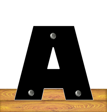 embedded: The letter A, in the alphabet set Construction, is black with silver nails embedded in letter.  Letter sits on wooden planks.