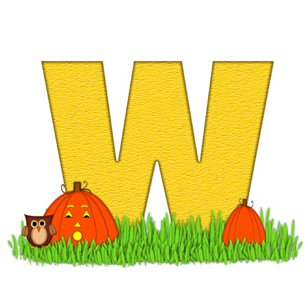 carved letters: The letter W, in the alphabet set Pumpkin Patch  is  a yellow and and sits in the green grass of a pumpkin patch.  Two orange pumpkins and an owl decorate letter. Stock Photo