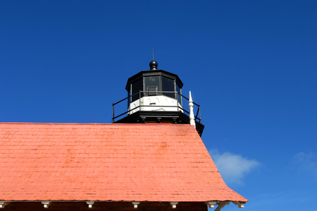 etched: Eagle Harbor Lighthouse is an historic landmark in Upper Peninsula, Michigan on Lake Superior.  Rooftop and nest is shown including the EH etched on outside of glass top. Stock Photo