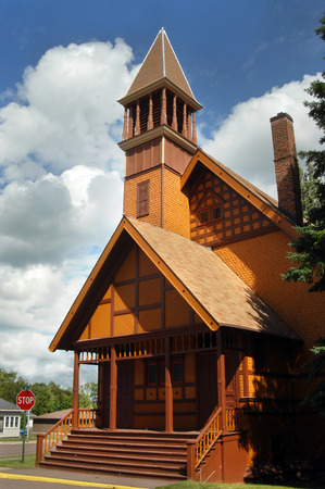 congregational: Gold, wooden, painted Church is an example of Victorian Stick Architecture.  First Congregational Church is located in Lake Linden, Michigan on the Upper Peninsula.