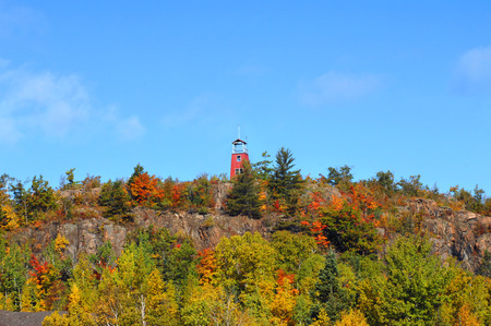 cliff top: Watch tower stands on cliff top overlooking the Phoenix Copper Mine area.  Fall colors fill image. Stock Photo