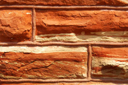 locally: Locally quarried, red sandstone forms foundation of the Houghton County Courthouse in Houghton, Michigan.