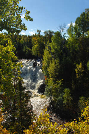 eagle falls: Eagle River spills over rocky ledge at Eagle River Falls in Upper Peninsula, Michigan.  Fall colors foreground. Stock Photo