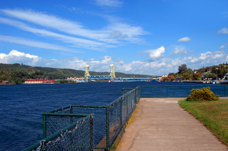 portage: The view from the East Houghton Waterfront Park includes both Houghton and Hancock, Michigan.  The Portage Lake Lift Bridge connects the two cities with Portage Lake between.