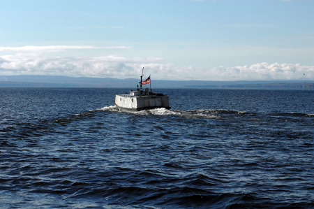 choppy: Built like a tank, and locally dubbed the Finish Submarine, the sturdy fishing vessel navigates the choppy waters of Lake Superior.