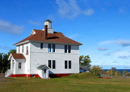 school house: Historic Eagle River School House has been converted into a community center and museum.  Museum is located in Eagle River, Michigan. Stock Photo