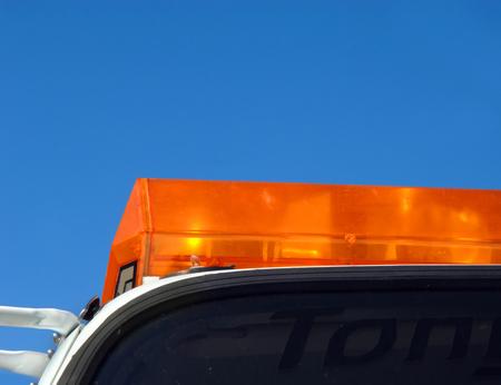 responds: Flashing yellow light tops an emergency response vehicle.  Tow truck responds to flat tire repair.