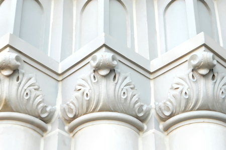 scrollwork: Abstract church pillars form rounded, pointed, and flat pattern in white and cream.  Angles add depth and uniformity.