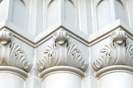 Details of church building includes scroll work and intricate pattern of architecture.  Angles add depth and uniformity.