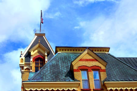 lintels: Victorian era courthouse is located in Houghton, Michigan.  Flag tops roof. Stock Photo