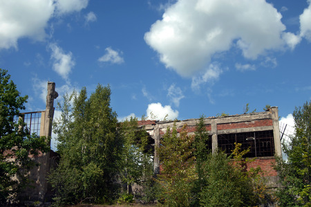 flotation: The Quincy Mill flotation building stands in ruins and overgrown with weeds and bushes.  This building is a remnant of the copper mining industry in the Upper Peninsula. Stock Photo