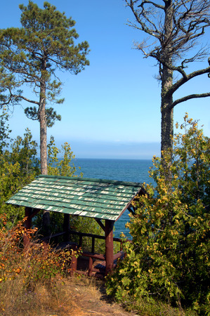 lake shore drive: Brockway Mountain Drive hugs the scenic shore of Lake Superior.  Rustic covered picnic and rest area gives terrific view of the lake.  Rustic timbers and green wooden shingle roof gives secluded rest area.